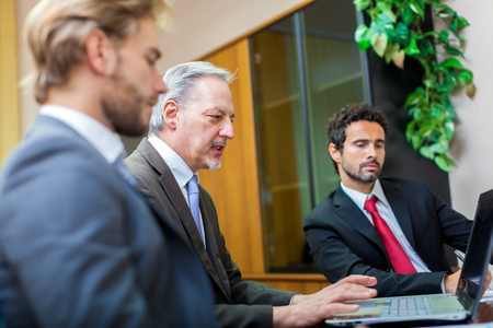 3 persons only: Business people at work in the office