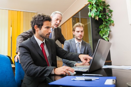 colleagues: Business people at work in their office Stock Photo