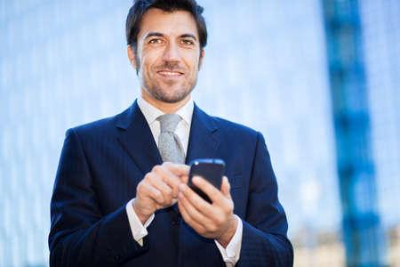 mature man: Mature businessman using his phone