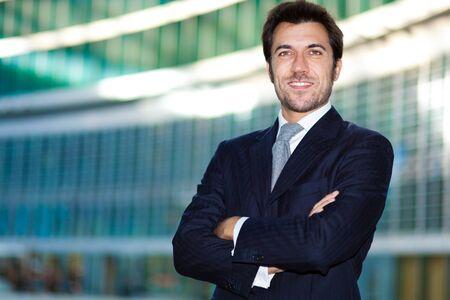 man in suit: Confident handsome businessman outdoor