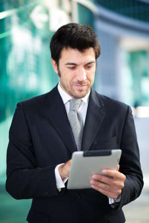 executive job search: Confident businessman using his tablet