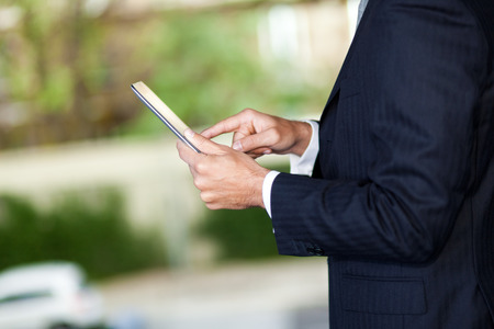Mature businessman using a tablet outdoor photo