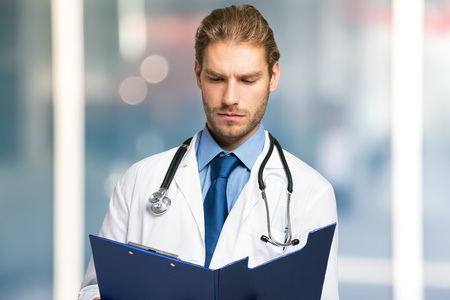 doctoring: Doctor reading a document