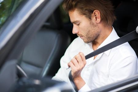 fastening: Man fastening his safety belt Stock Photo