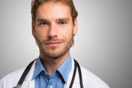 doctoring: Portrait of a smiling handsome doctor