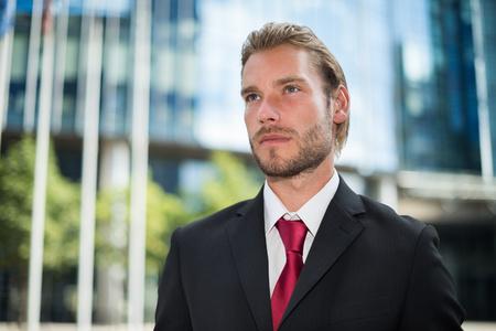 slight: Portrait of an handsome smiling businessman