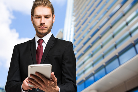eye pad: Blonde businessman using a tablet pc