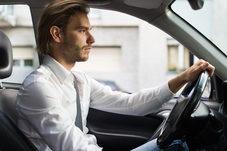 Portrait of a man driving his car Stock Photo