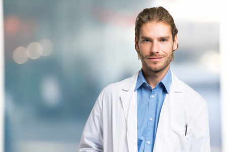 white coat: Portrait of an handsome smiling doctor portrait