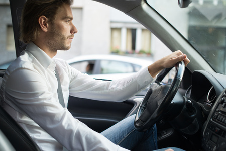 Portrait of a man driving his car Standard-Bild