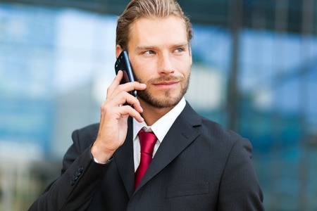 phonecall: Handsome man talking at the phone outdoor