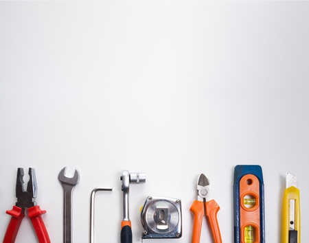 Various tools over a blank panel 写真素材