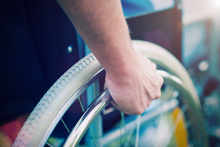 handicapped: Detail of a disabled man on a wheelchair