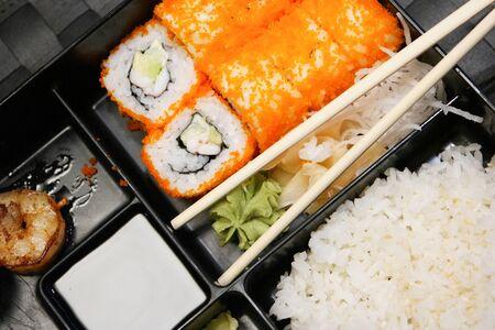 bento box: Bento box with salad, maki, shrimps and rice