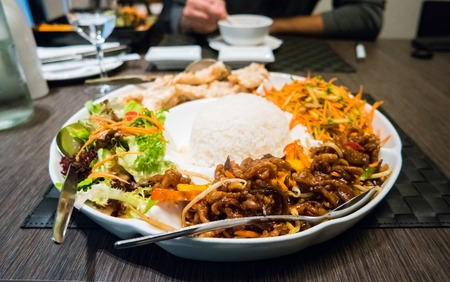 asian foods: Big plate containing many different foods in an asian restaurant