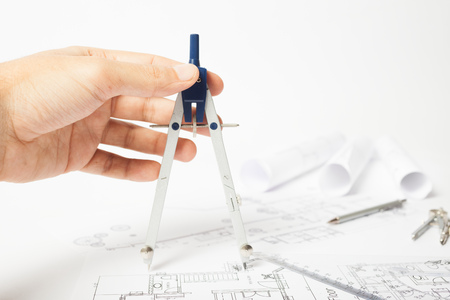 architect drawing: Architect using compasses on a drawing Stock Photo