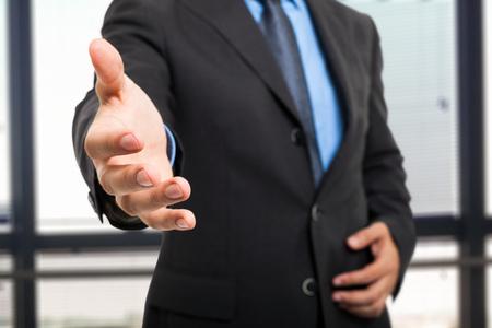 Business man offering an handshake