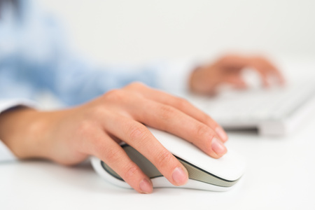 female hands: Detail of a person using a computer