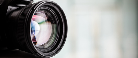 Close-up of a digital camera. Large copyspace