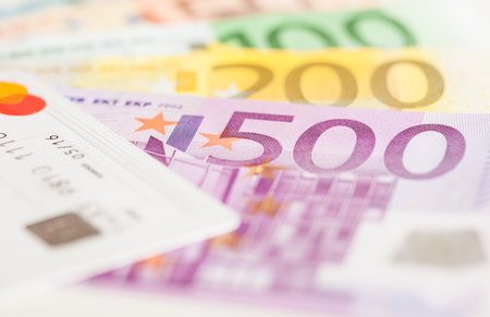 credit union: Euro bills and credit card background