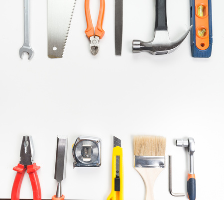 modifying: Various tools over a blank panel Stock Photo