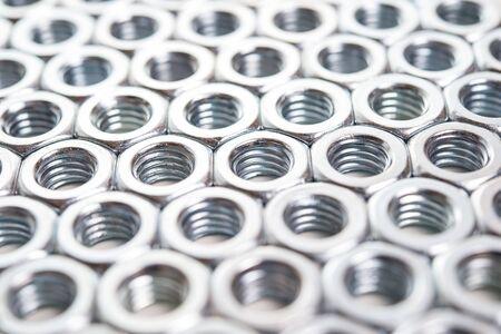 metalware: Metal nuts background