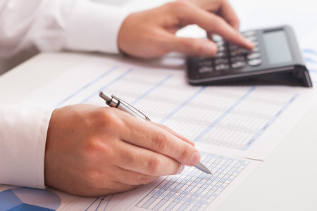 hand pen: Accountant writing on a business document Stock Photo