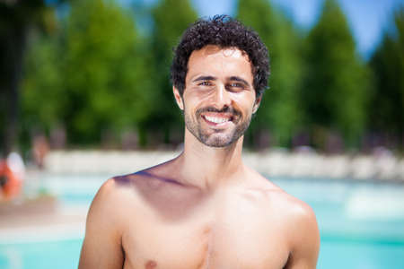 white face: Handsome man enjoying the summer in a swimming pool