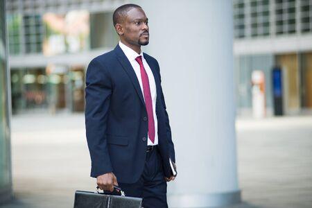 briefcase: Portrait of a businessman holding his briefcase