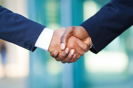 black hands: African businessman shaking hands with a caucasian one