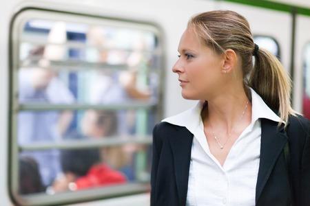 blond girl: Businesswoman portrait inside metro subway