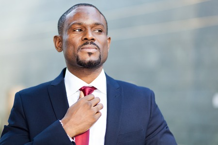 american banker: Confident black businessman outdoor