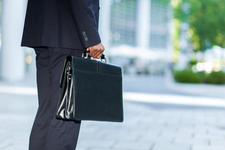 black businessman: Black businessman carrying a briefcase