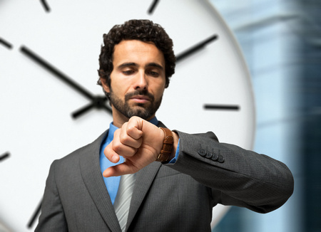 prompt: Businessman looking at his watch