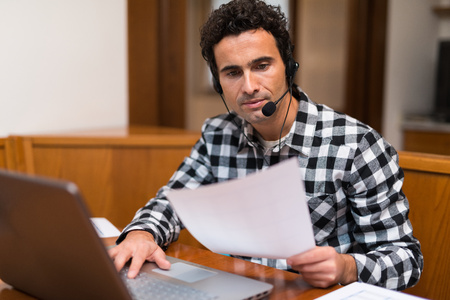 telecommuting: Portrait of a man working at home Stock Photo