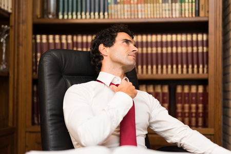 finished good: Mature man relaxing in his office after work Stock Photo