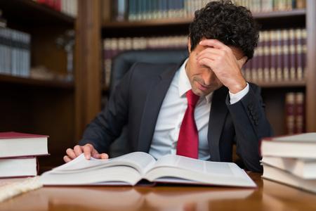 tedious: Portrait of a businessman reading a book