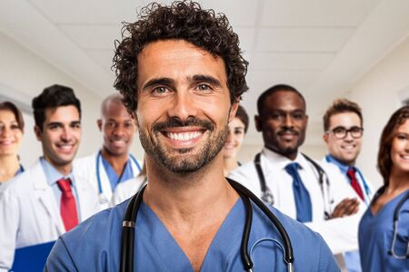 Portrait of a smiling doctor in front of his medical team