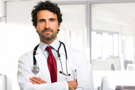 doctoring: Portrait of an handsome young doctor