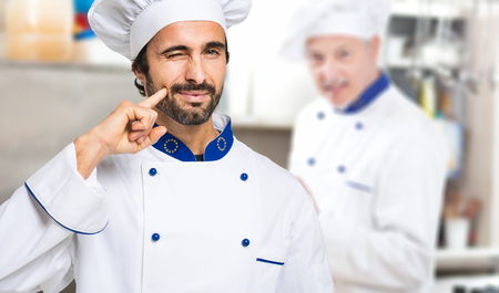 catering food: Portrait of a Chef at work in his Kitchen