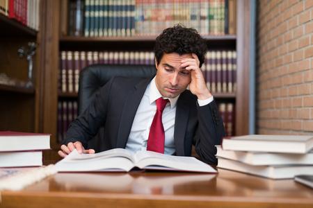 researcher: Portrait of a businessman reading a book