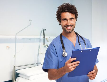 doctoring: Portrait of a smiling doctor in a bright clinic room