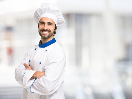 Portrait of a smiling chef in front of a bright background 免版税图像 - 55653263