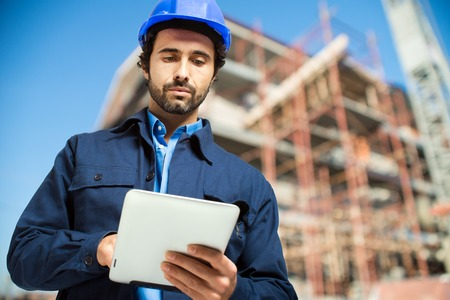 Construction specialist using a tablet computer Standard-Bild