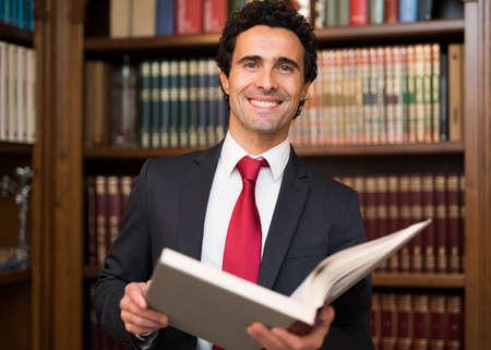 standing businessman: Portrait of a businessman reading a book