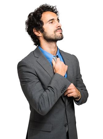 adjusting: Handsome businessman adjusting his tie Stock Photo