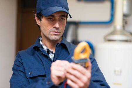 the tester: Portrait of an electrician using a tester Stock Photo