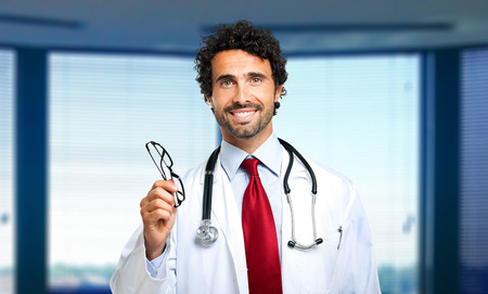 ophthalmic: Young doctor giving you a pair of eyeglasses Stock Photo