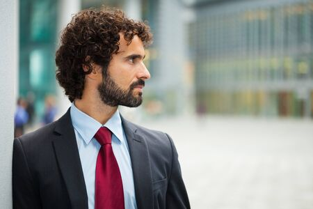 councilor: Portrait of an handsome businessman looking at his side Stock Photo