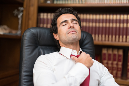 loosing: Businessman loosing his necktie after an hard working day